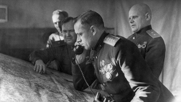 General konstantin rokossovsky, commander of the first byelorussian front, on the phone prior to the battle for stalingrad, on the right is lieutenant general telegin, member of the military council of the front.